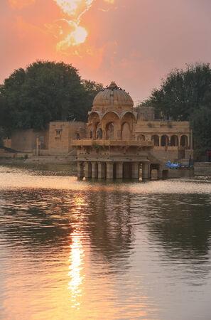 sagar: Gadi Sagar temple on Gadisar lake at sunset, Jaisalmer, Rajasthan, India
