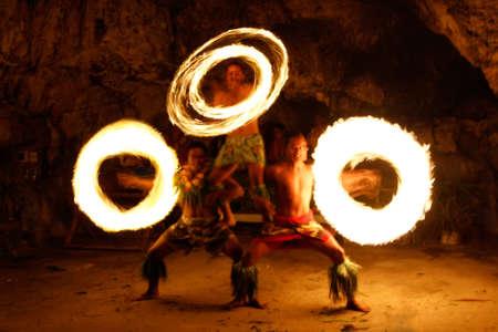 Fire show in famous Hina cave, blurred motion, Oholei beach, Tongatapu island, Tonga