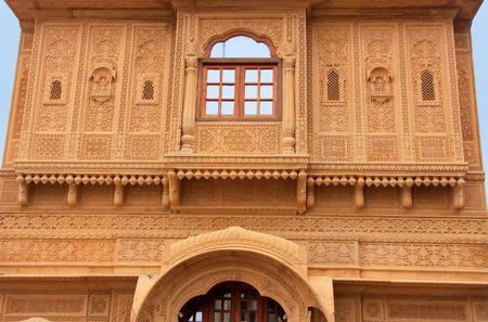 Decorative carving on traditional haveli, Jaisalmer, Rajasthan, India photo