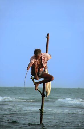 Stick fisherman in Unawatuna, Sri Lanka