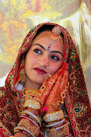 Young woman in traditional dress taking part in Desert Festival, Jaisalmer, Rajasthan, India