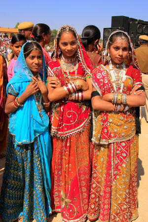 indian bride: Young women in traditional dress taking part in Desert Festival, Jaisalmer, Rajasthan, India Editorial