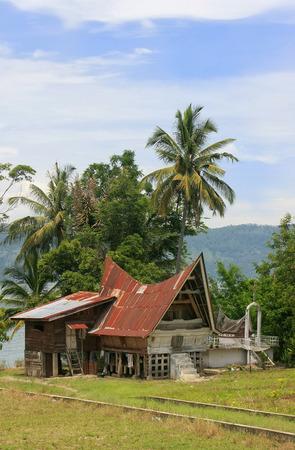 sumatra: Traditional Batak house on Samosir island, Sumatra, Indonesia, Southeast Asia Editorial