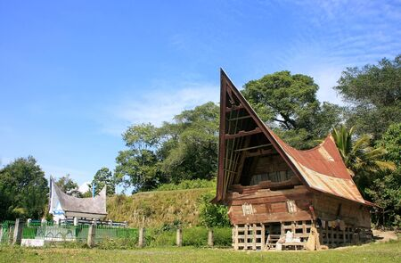 indonesia culture: Traditional Batak house on Samosir island, Sumatra, Indonesia, Southeast Asia Stock Photo