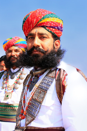 mr: Indian men in traditional dress taking part in Mr Desert competition, Jaisalmer, Rajasthan, India Editorial