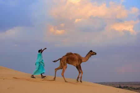thar: Bedouin leading his camel in Thar desert near Jaisalmer, Rajasthan, India