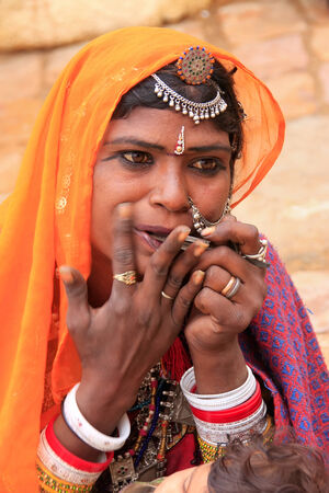 thar: Indian woman playing on mouth harp, Jaisalmer fort, Rajasthan, India