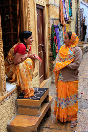 Indian women talking in the street of Jaisalmer fort, Rajasthan, India