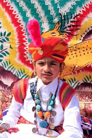local festivals: Indian boy in traditional dress taking part in Desert Festival, Jaisalmer, Rajasthan, India