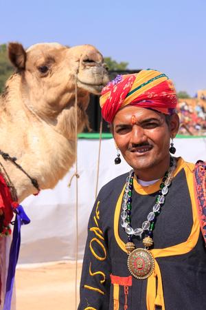 jaisalmer: Indian man with a camel taking part in Desert Festival, Jaisalmer, Rajasthan, India Editorial