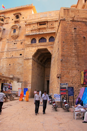People walking through the main entrance of Jaisalmer fort, Rajasthan, India