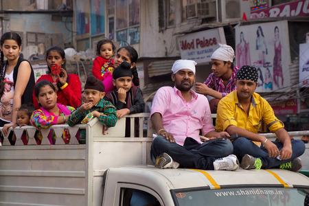 procession: People taking part in car procession during Guru Nanak Gurpurab celebration in New Delhi, India