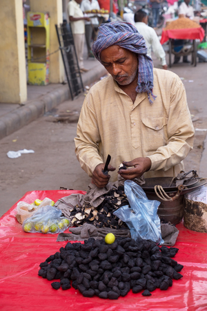 new delhi: Indian man selling fruits in the street of New Delhi, India