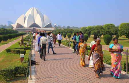 lotus temple: People walking to and from Lotus temple in New Delhi, India. it serves as the Mother Temple of the Indian subcontinent and has become a prominent attraction in the city.