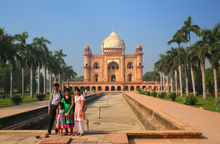 mughal empire: Indian family standing in front of Tomb of Safdarjung in New Delhi, India. It was built in 1754 in the late Mughal Empire style.