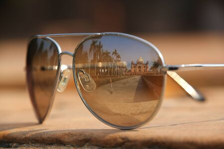 mughal: Tomb of Safdarjung reflected in sunglasses. Tomb was built in 1754 in the late Mughal Empire style in New Delhi, India