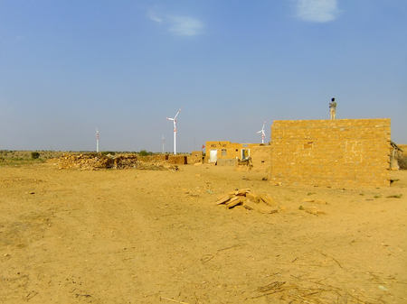 thar: Small village with traditional houses in Thar desert near Jaisalmer, Rajasthan, India. Thar desert forms a natural boundary between India and Pakistan Stock Photo