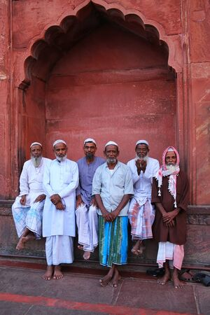 hold up: Muslim men standing at Jama Masjid in Delhi, India. The courtyard of the mosque can hold up to twenty-five thousand worshippers.