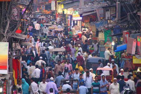 View of Chawri Bazar street full of people in the evening from Jama Masjid, Old Delhi, India. Редакционное