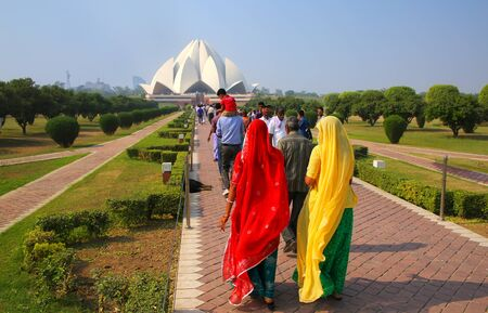 lotus temple: People walking to Lotus temple in New Delhi, India. it serves as the Mother Temple of the Indian subcontinent and has become a prominent attraction in the city.