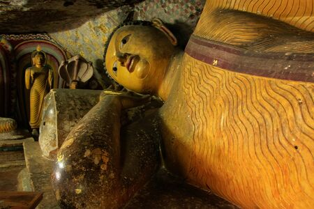 sri lanka temple: Reclining Buddha at Golden Temple of Dambulla in Sri Lanka. It is the largest and best preserved cave temple complex in the country.