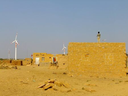 thar: Small village with traditional houses in Thar desert near Jaisalmer, Rajasthan, India. Thar desert forms a natural boundary between India and Pakistan Editorial