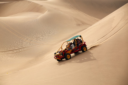 Dune buggy in a desert near Huacachina, Ica region, Peru.