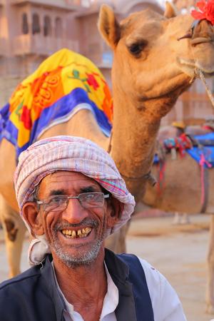 sagar: Indian mand standing with camel at Man Sagar Lake in Jaipur, Rajasthan, India.