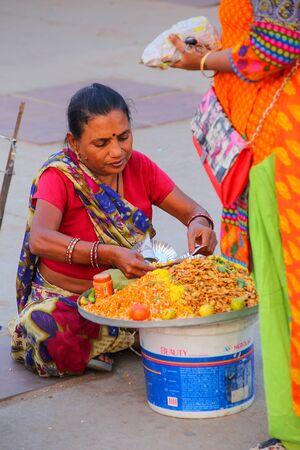 sagar: Woman selling food by Man Sagar Lake in Jaipur, Rajasthan, India. Editorial