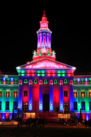 christmas in denver: Denver City and County Building illuminated at night, Colorado. Denver is the most populous city in Colorado.