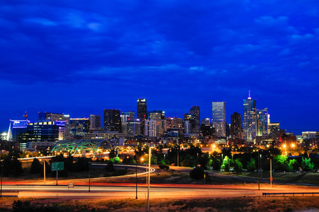denver city skyline: Skyline of Denver at night in Colorado, USA.  Denver is the most populous city in Colorado. Stock Photo