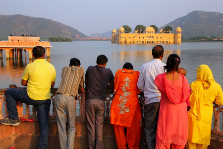 rajput: People enjoying view of Jal Mahal and Man Sagar Lake in Jaipur, Rajasthan, India. Jal Mahal was built in the Rajput and Mughal styles.