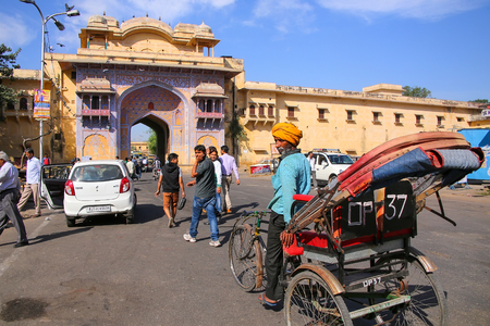 rajput: Cycle rickshaw near City Palace in Jaipur, India. Palace was the seat of the Maharaja of Jaipur, the head of the Kachwaha Rajput clan.