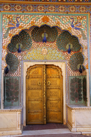 rajput: Peacock Gate in Pitam Niwas Chowk, Jaipur City Palace, Rajasthan, India. Palace was the seat of the Maharaja of Jaipur, the head of the Kachwaha Rajput clan.
