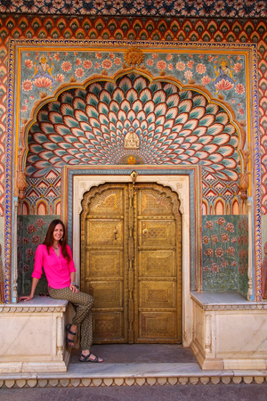 rajput: Young woman sitting at Lotus Gate in Pitam Niwas Chowk, Jaipur City Palace, Rajasthan, India. Palace was the seat of the Maharaja of Jaipur, the head of the Kachwaha Rajput clan.