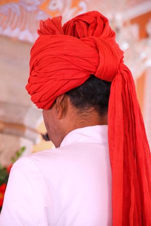 maharaja: Close up of turban of a guard at Diwan-i-Khas in Jaipur City Palace, Rajasthan, India. Palace was the seat of the Maharaja of Jaipur, the head of the Kachwaha Rajput clan.