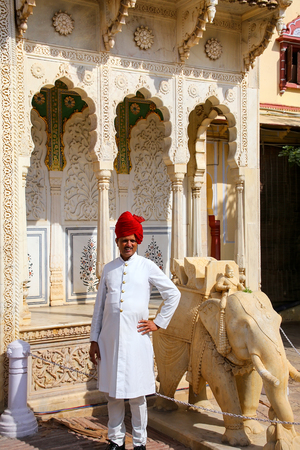 rajput: Indian guard standing at Rajendra Pol in Jaipur City Palace, Rajasthan, India. Palace was the seat of the Maharaja of Jaipur, the head of the Kachwaha Rajput clan.