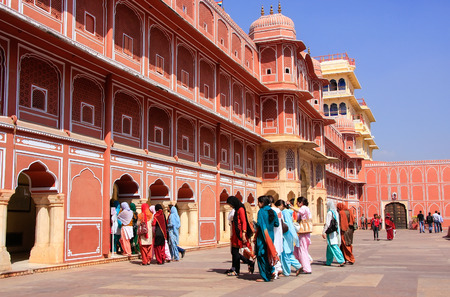 rajput: Group of visitors at Chandra Mahal in Jaipur City Palace, Rajasthan, India. Palace was the seat of the Maharaja of Jaipur, the head of the Kachwaha Rajput clan.