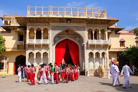 maharaja: Local school kids walking out of Rajendra Pol in Jaipur City Palace, Rajasthan, India. Palace was the seat of the Maharaja of Jaipur, the head of the Kachwaha Rajput clan.
