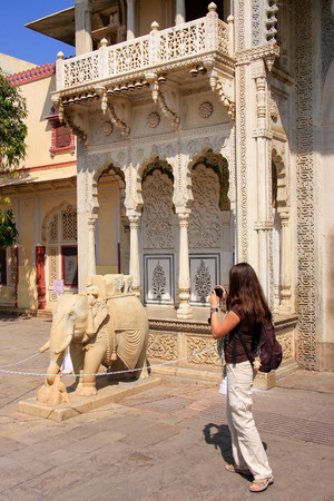 rajput: Tourist taking photo of Rajendra Pol in Jaipur City Palace, Rajasthan, India. Palace was the seat of the Maharaja of Jaipur, the head of the Kachwaha Rajput clan.