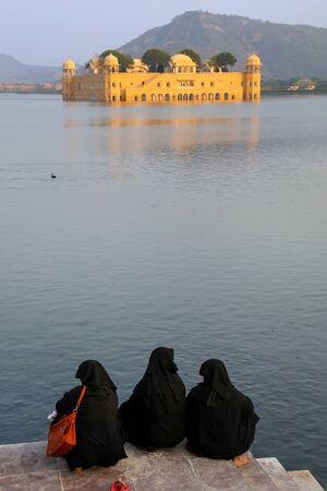 sagar: Muslim women sitting on the shore of Man Sagar Lake in Jaipur, Rajasthan, India. Editorial