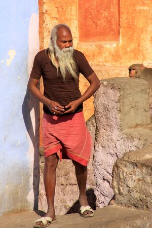 house robes: Local man standing by his house in Jaipur, India. Jaipur is the capital and largest city of the Indian state of Rajasthan.