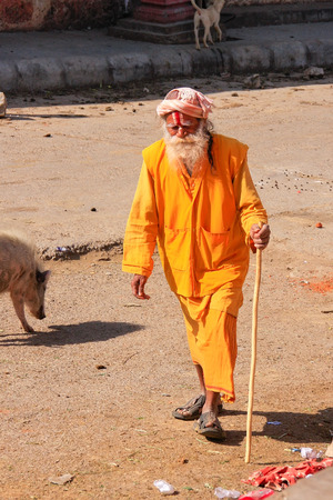 pilgrim costume: Local man walking to Galta Temple in Jaipur, India. Jaipur is the capital and largest city of the Indian state of Rajasthan. Editorial