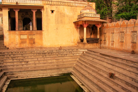 temple tank: Galtaji Temple near Jaipur, Rajasthan, India. It consists of a series of temples built in to a narrow crevice in the ring of hills that surround Jaipur.