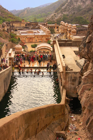 crevice: Galtaji Temple near Jaipur, Rajasthan, India. It consists of a series of temples built in to a narrow crevice in the ring of hills that surround Jaipur.