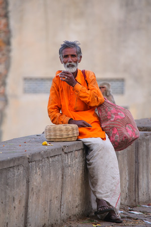 charmer: Local snake charmer sitting in the street of Jaipur, India. Jaipur is the capital and largest city of the Indian state of Rajasthan.