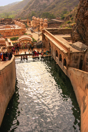 a bathing place: Galtaji Temple near Jaipur, Rajasthan, India. It consists of a series of temples built in to a narrow crevice in the ring of hills that surround Jaipur.