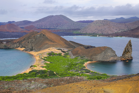 pinnacle: View of Pinnacle Rock on Bartolome island, Galapagos National Park, Ecuador. This island offers some of the most beautiful landscapes in the archipelago.