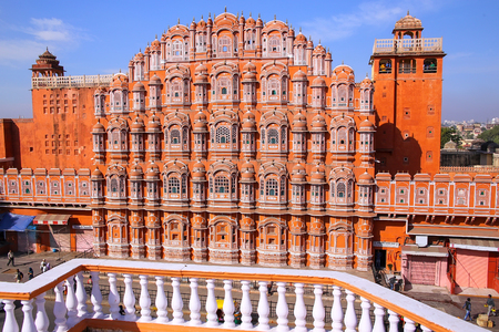 latticework: Hawa Mahal - Palace of the Winds in Jaipur, Rajasthan, India. It was designed by Lal Chand Ustad in the form of the crown of Krishna, the Hindu god.