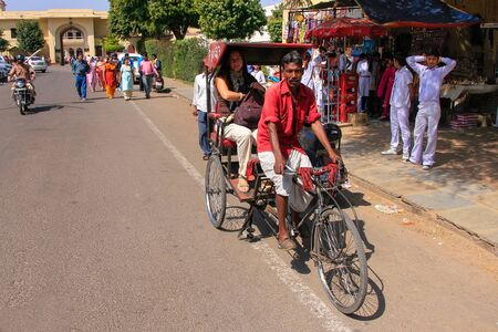 jaipur: Cycle rickshaw driving in the streets of Jaipur, Rajasthan, India. Jaipur is the capital and the largest city of Rajasthan.